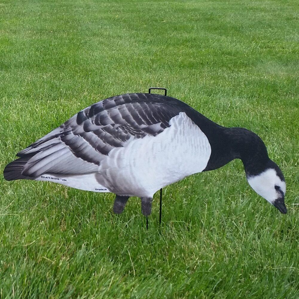 Image of Big Al's Silhouette Barnacle Decoys from a side view on a grass field. The decoy is in a feeding position.